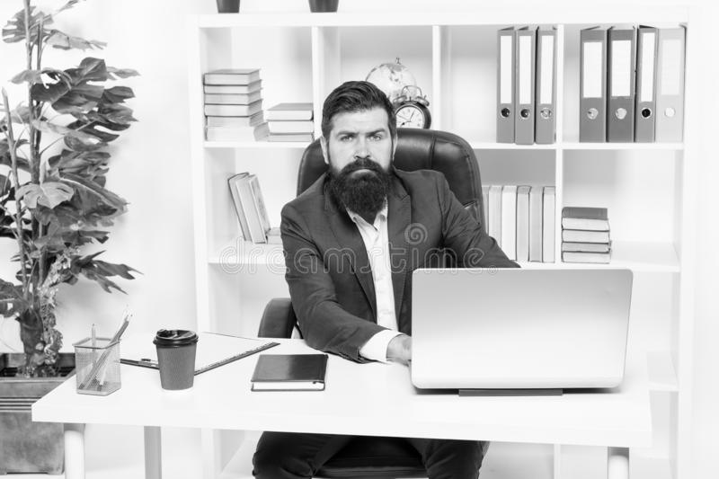 Office staff concept. Office routine. Businessman in charge of business solutions. Developing business strategy. Risky. Business. Man bearded boss sit with stock photography