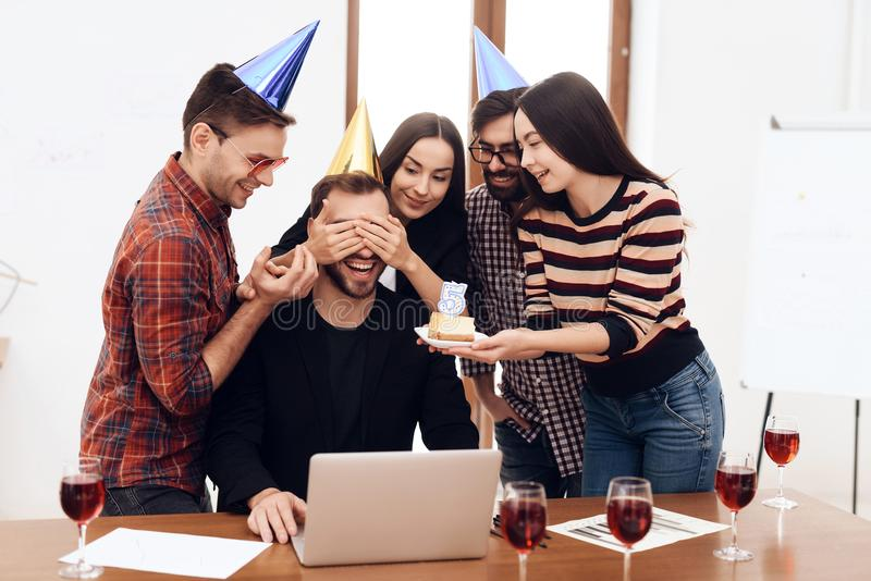The office staff surprises their manager. stock photos