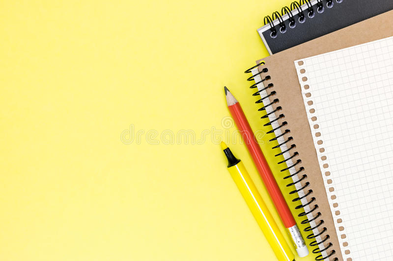 Office stationary with two clean notebooks and sheet of paper on royalty free stock image