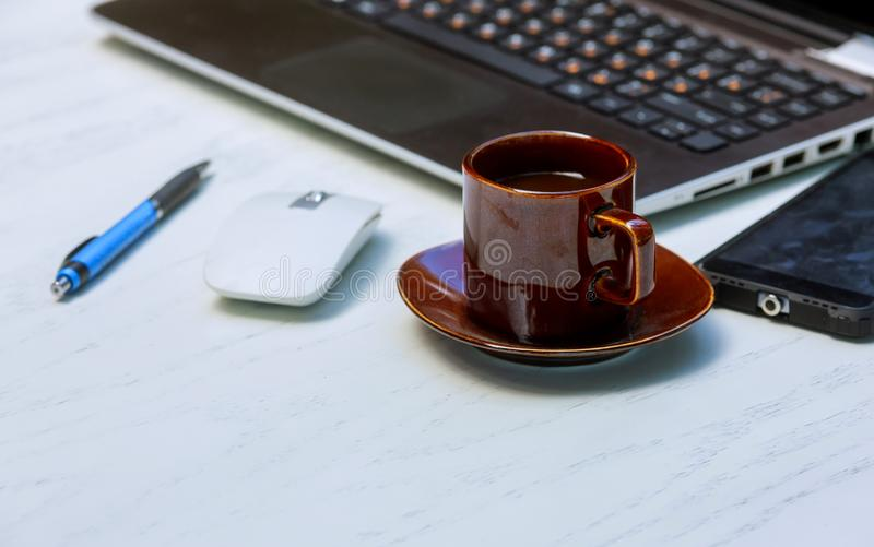 office stuff with smart phone laptop and coffee cup mouse notepad top stock photography