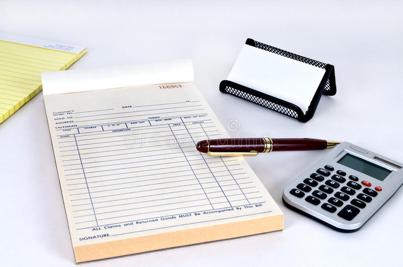 Office supplies. A legal pad, receipt book and other office supplies stock photo