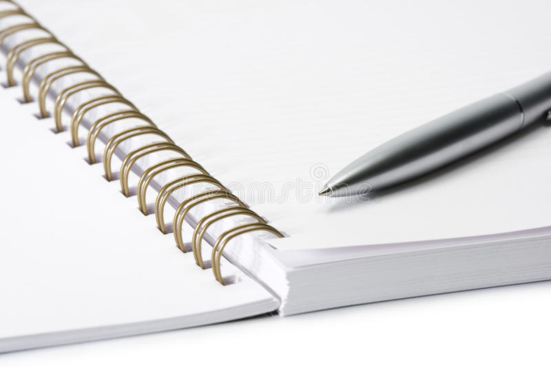 Office supplies. Pen and note pad stock images
