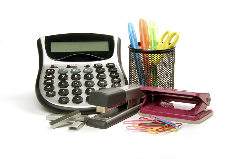 Office supplies. Including a calculator, punch, stapler, paperclips and scissors stock photo