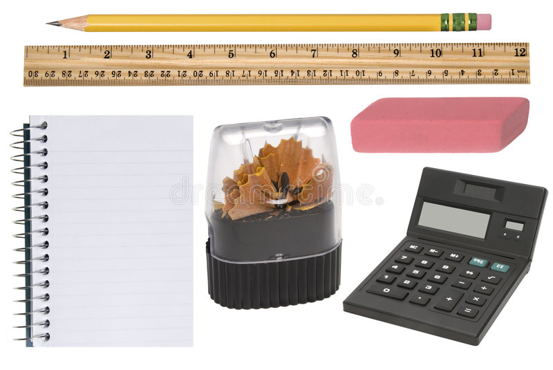 Office supplies. Isolated office supplies in new condition incluldes a freshly sharpened pencil, pencil sharpener, eraser, notepad and calculator royalty free stock photo
