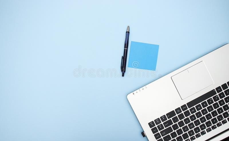 Office supplies on blue background stock images