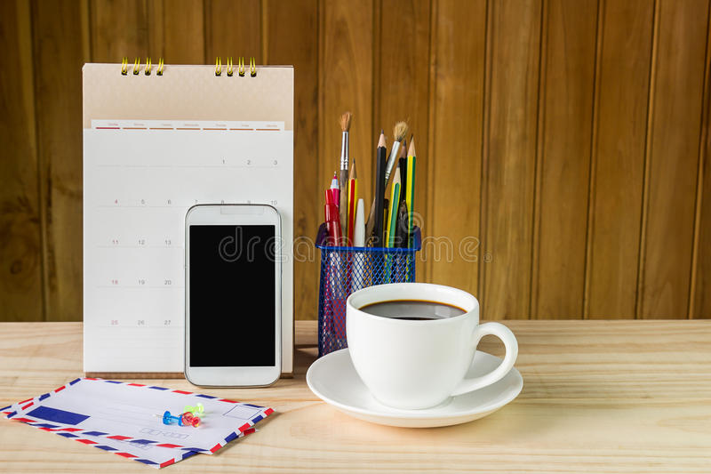 Office supplies and coffee on wooden table stock photos