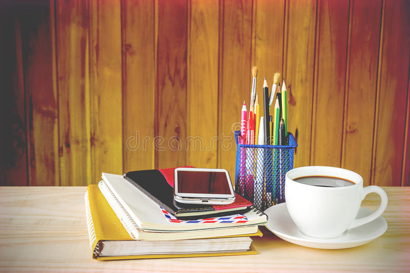 Office supplies and coffee on wooden table royalty free stock photo