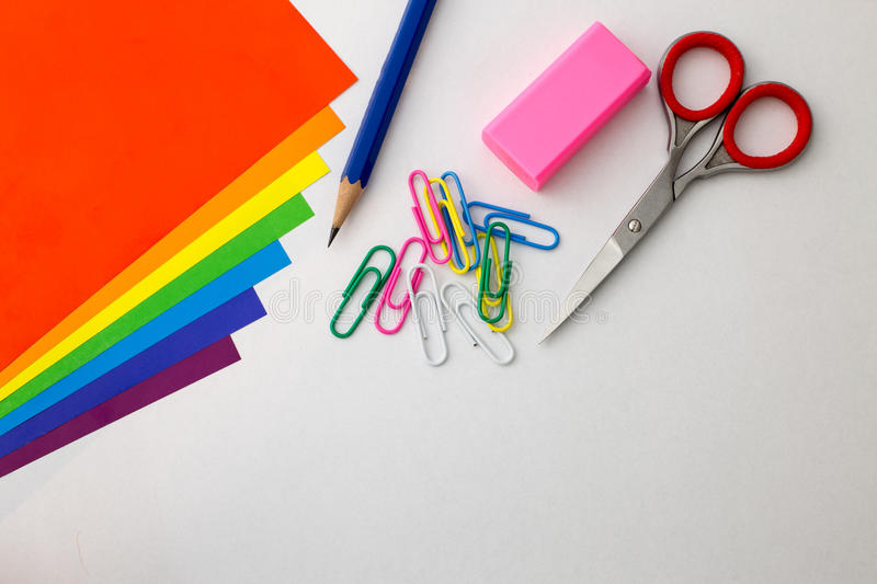 Office supplies with rainbow colors of papers. royalty free stock images