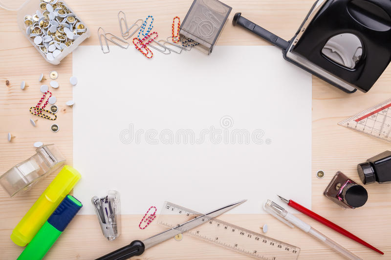 Office supplies. And a white piece of paper in the center stock photography
