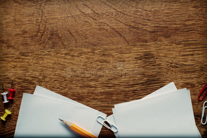 Office Supplies on Wooden Surface with Copy Space stock photo