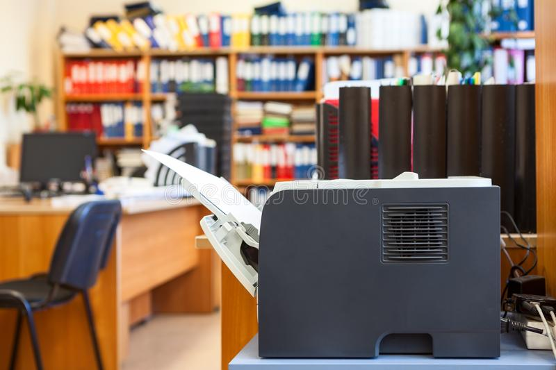 Office supply: printer device is in an empty corporate room stock photo