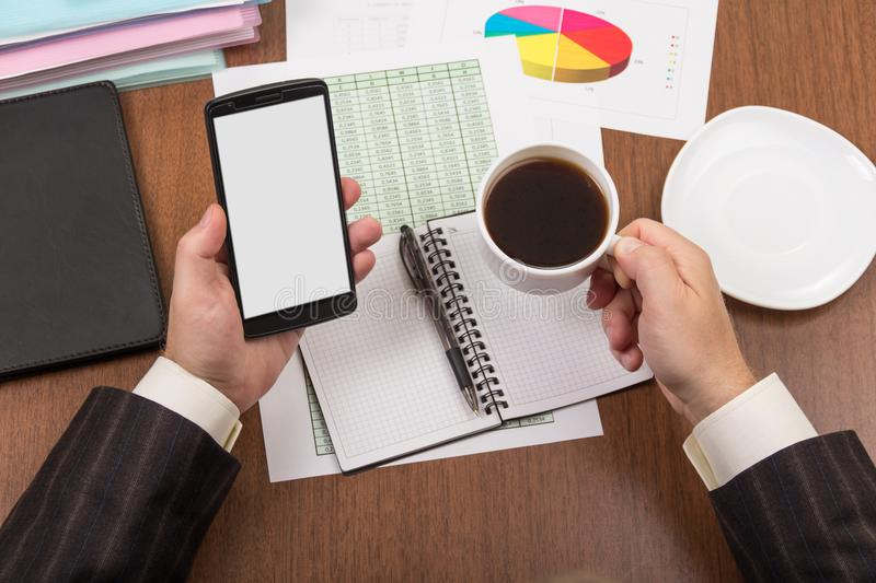 Office table with accessories, folders and documents, cup of coffee stock photography