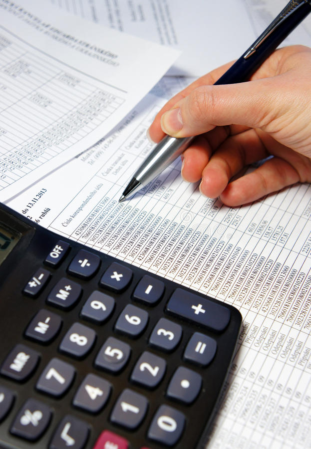 Office table with calculator, pen and accounting document stock photo