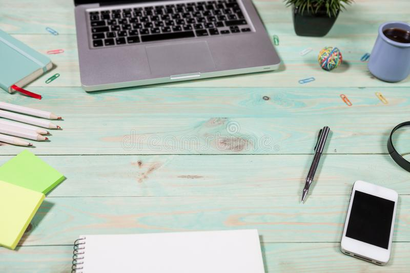 Office table desk with set of colorful supplies. Blue office desk table with with office supplies. Top view with copy space royalty free stock photos