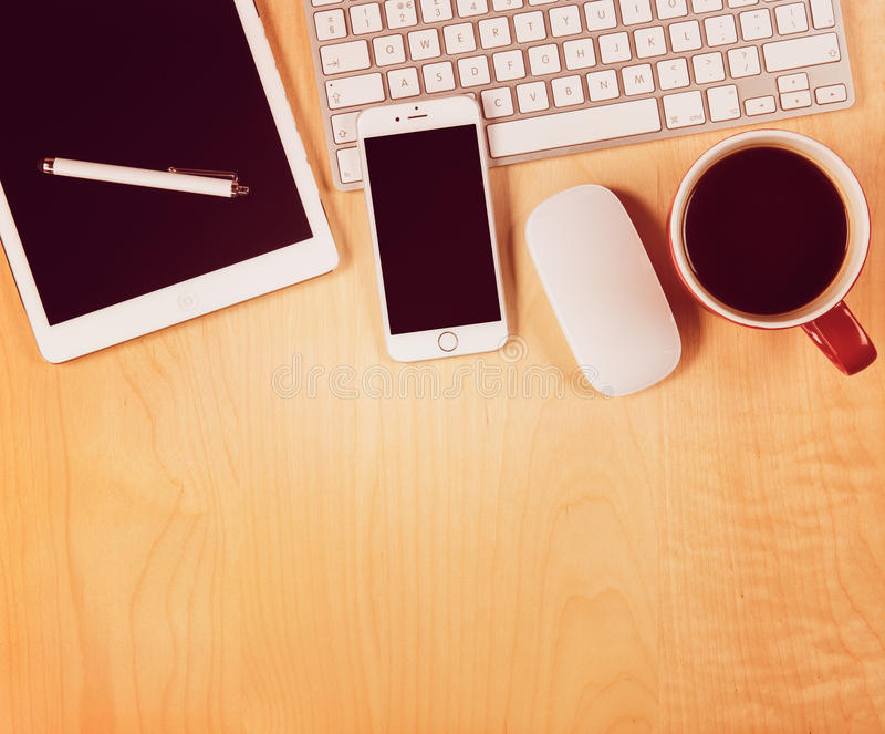 Office table with digital tablet, smartphone and cup of coffee. View from above. With copy space royalty free stock photography