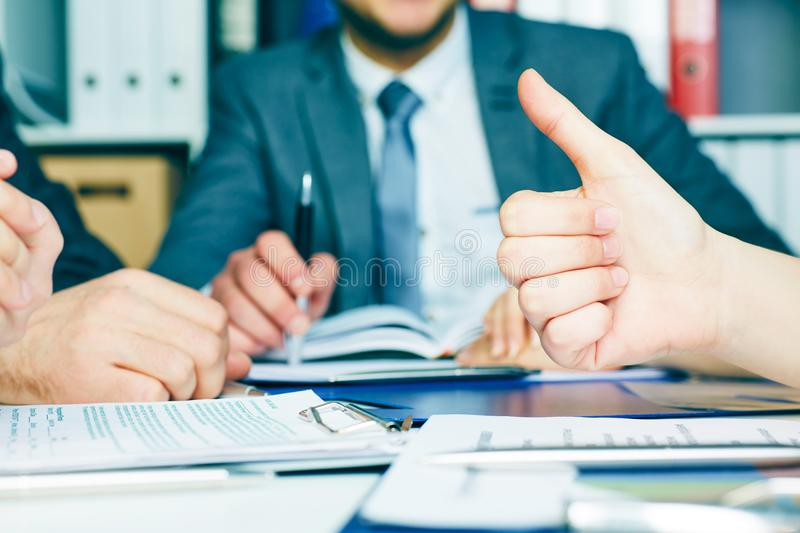Business team networking concept - office table with many printed professional paper charts and hands of young people stock photos