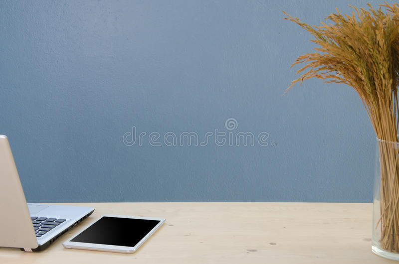 Office table with notepad, computer and dry tree. View from above with notepad space. royalty free stock photo