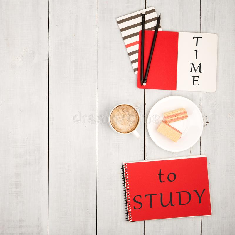 Office table with notepads and inscription & x22;TIME to STUDY& x22;, cup of coffee and waffles stock images
