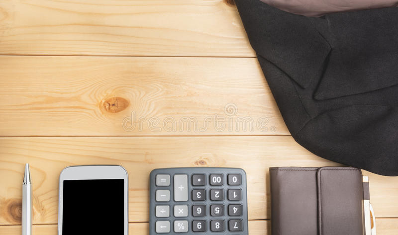 Office table with pen, wallet, calculator, suit and smart-phone. View from above with copy space. royalty free stock photos