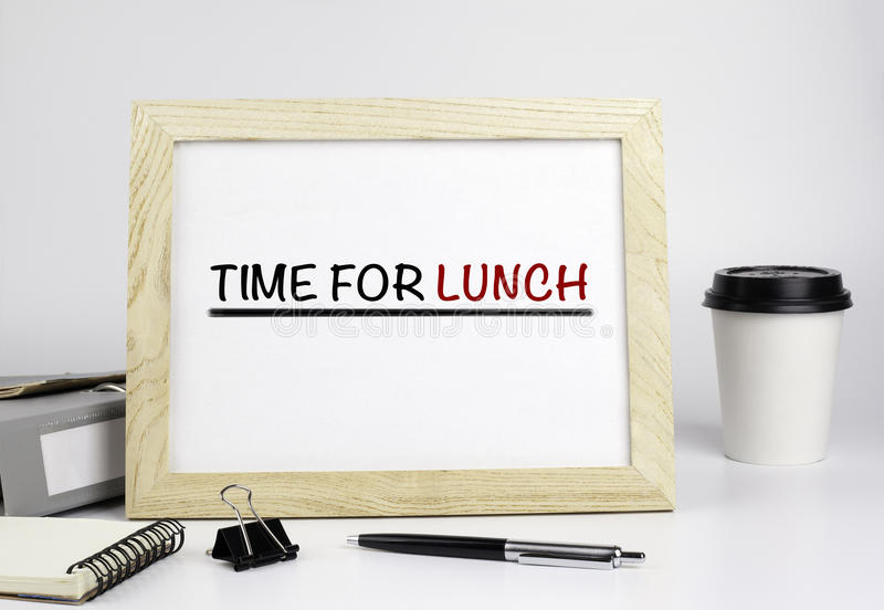 Office table with wooden frame with text - Time for lunch royalty free stock images