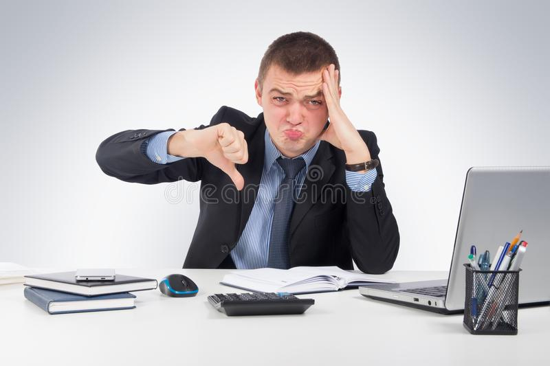 Disappointed young business man with thumb down stock photography