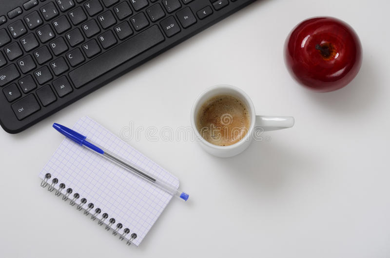 Office top view, laptop, notebook, coffee, apple. For good working stock photos