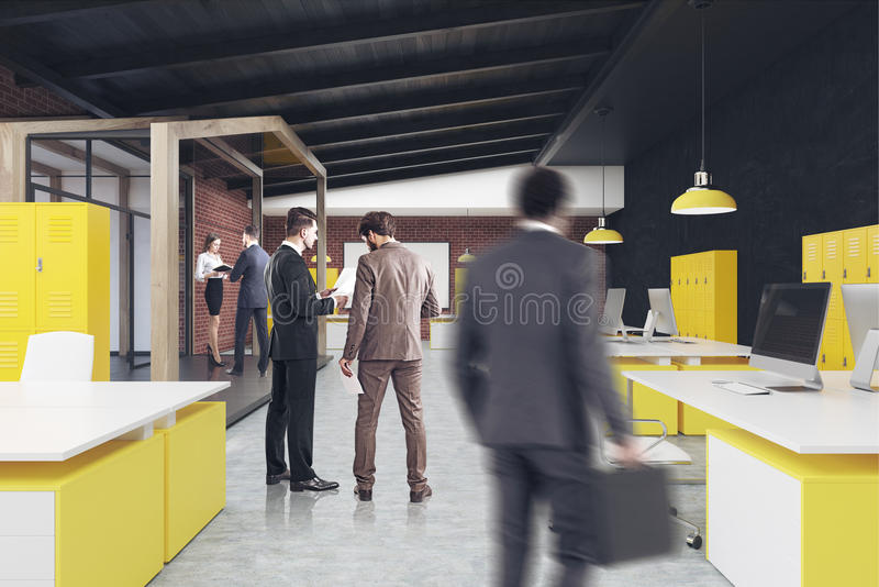 Office with a whiteboard, people. Business people in an office interior with rows of white and yellow tables, computers standing on them and a whiteboard hanging stock photo