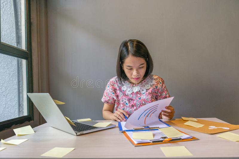 Office woman checking financial report documents in the office royalty free stock photography