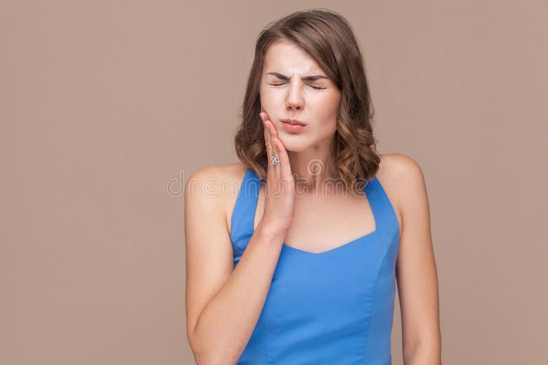 Office woman closed eyes and have a dental, teeth pain stock image