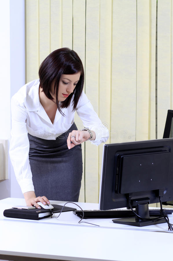 Office woman in a hurry royalty free stock photos