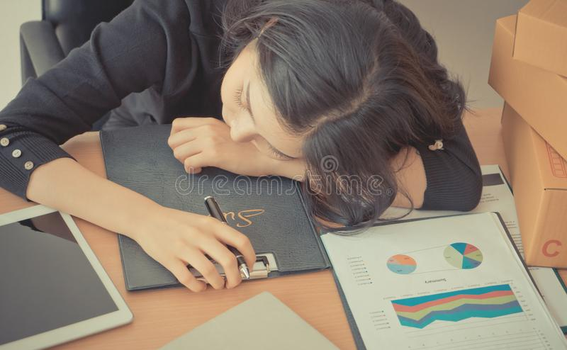 Office woman sleeping over her office desk royalty free stock image