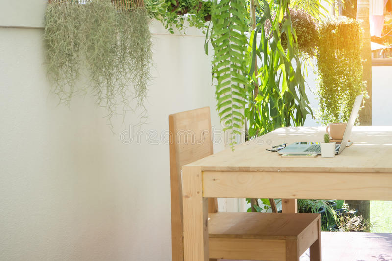 Office wood table and chair in the garden, natural work place at royalty free stock photo