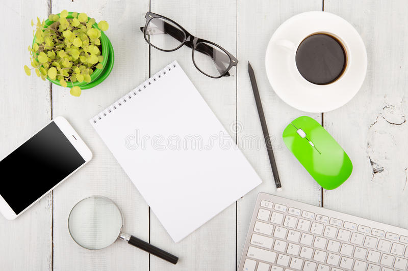 Office wooden desk with pc keyboard and other supplies. Office wooden desk with pc keyboard, notepad, phone and other supplies royalty free stock photo