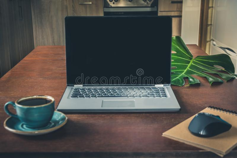 Office wooden desk table with laptop in interior. Top view with copy space. royalty free stock image