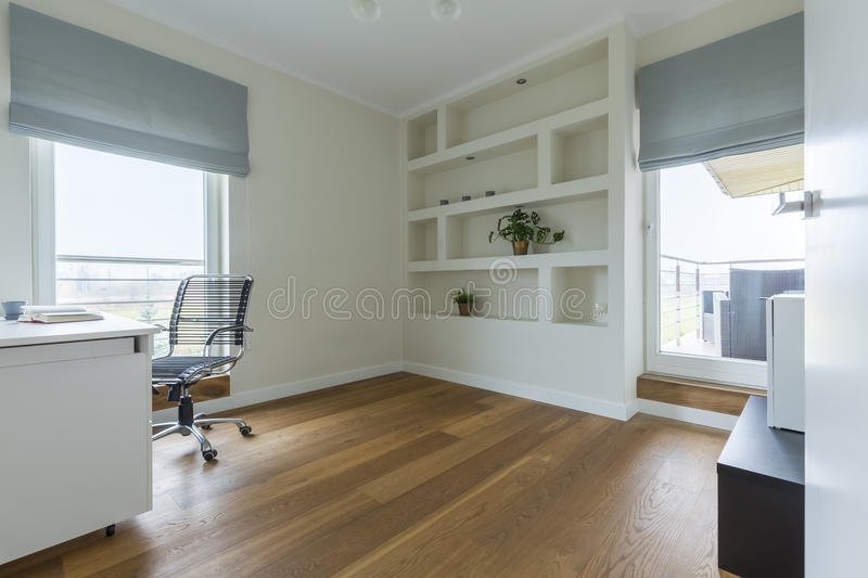 Office with wooden floor. Spacious modern designed office with white furniture and wooden floor stock photography