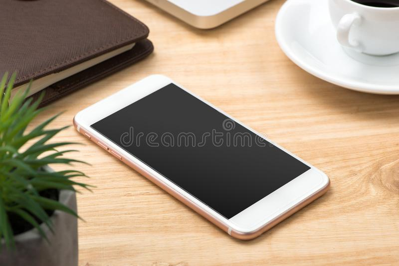 Office work table with smartphone mock up. Office work table with smartphone mock up royalty free stock images