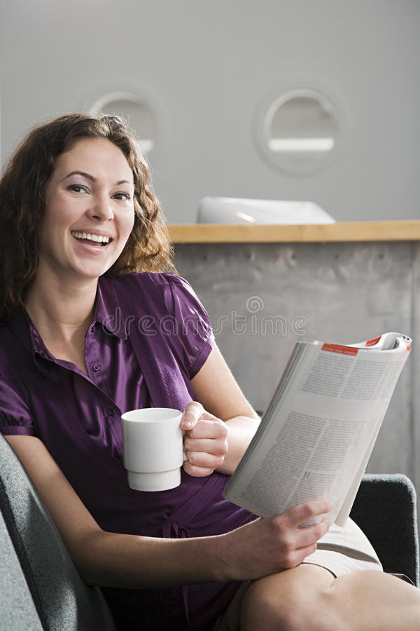 Office worker with coffee and magazine stock images