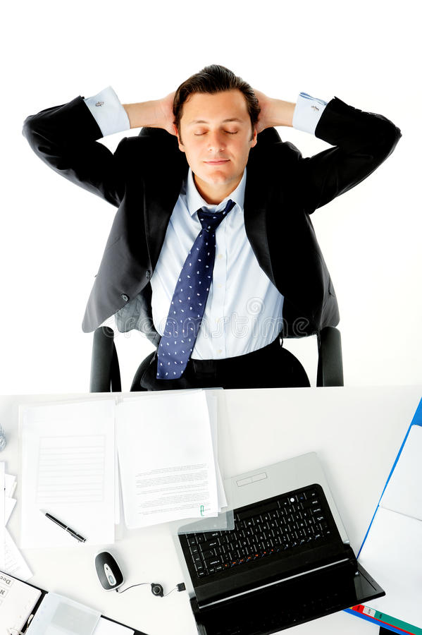 Office worker daydreams. Businessman is distracted while on the job stock image