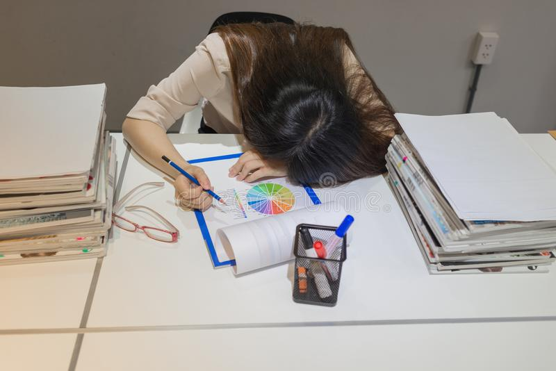 Office worker fall asleep while reviewing data royalty free stock photos
