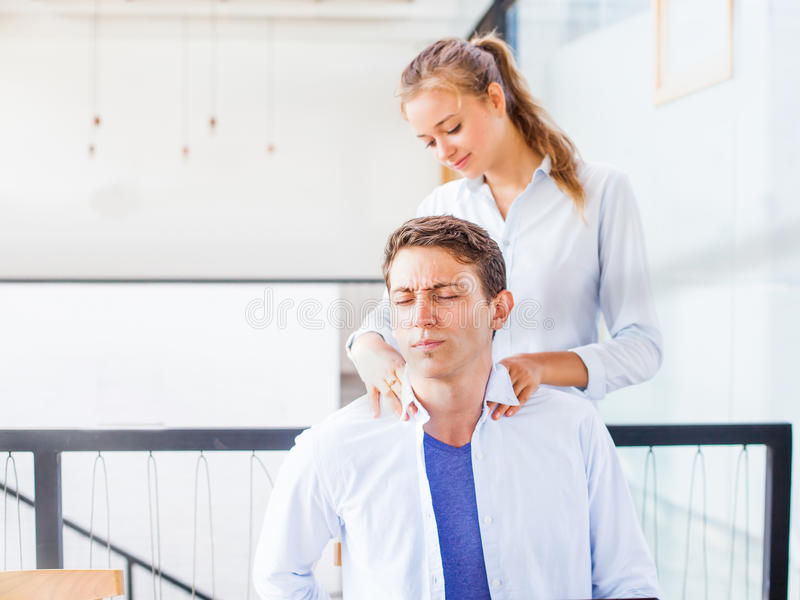 Office worker getting massage on his workplace stock photo