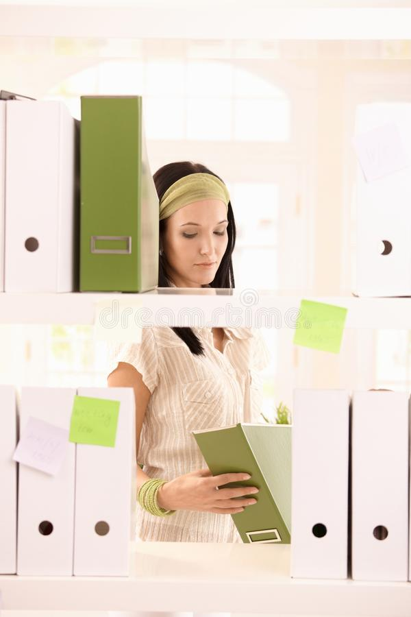 Download Office Worker Girl Packing Folders Stock Image - Image: 21955617