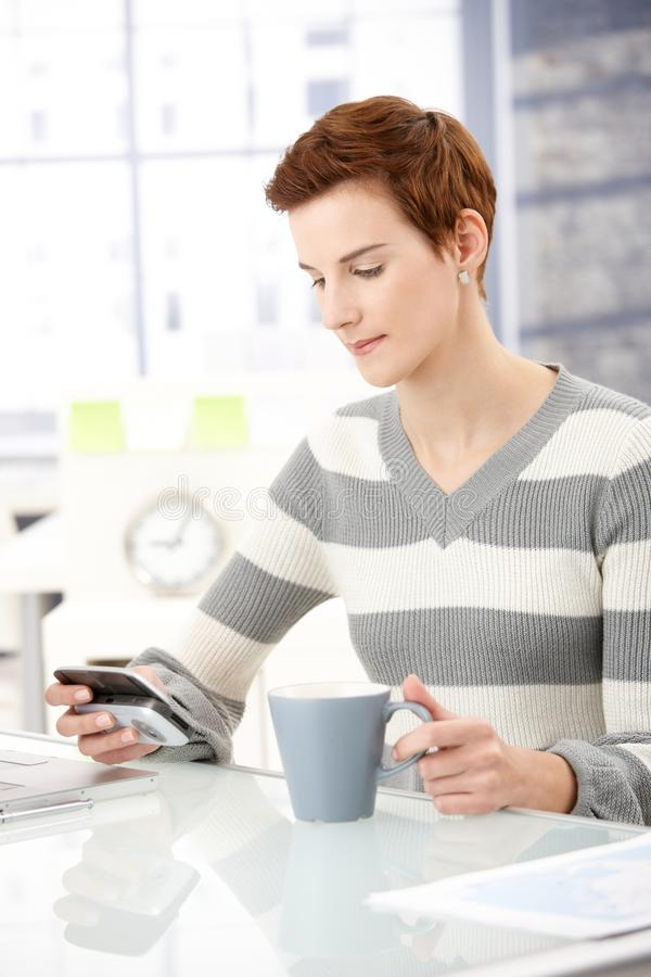 Office worker girl with smartphone stock image