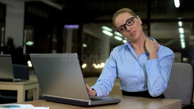 Office worker having neck pain, sitting on uncomfortable chair, muscle strain stock photos