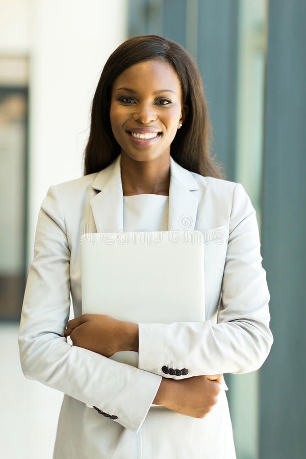 office worker holding laptop stock photos