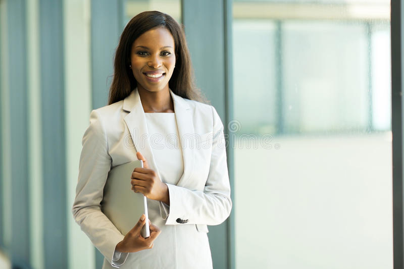 Office worker holding laptop royalty free stock image