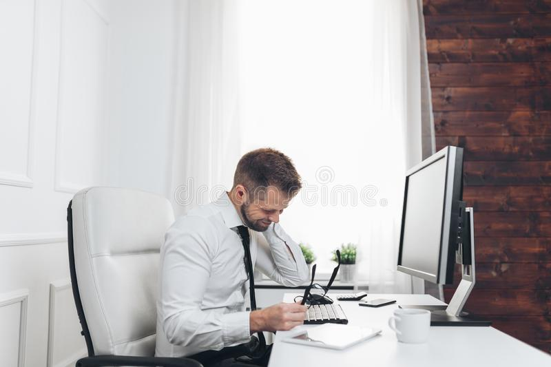 Office worker with pain from sitting at desk all day royalty free stock photo