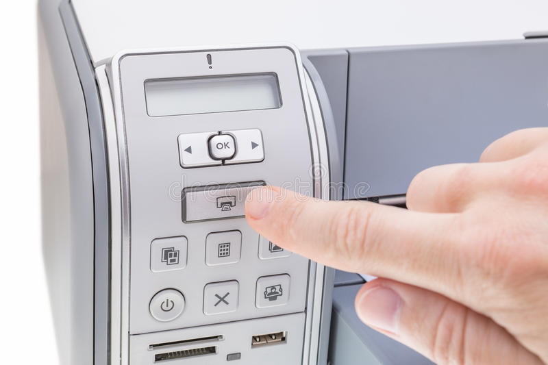 Office worker presses the button the printer. royalty free stock images