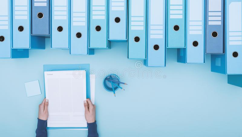 Office worker and archive binders royalty free stock photos