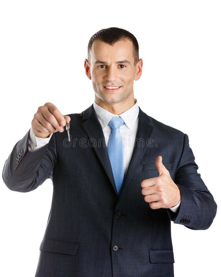 Office worker shows key royalty free stock photography
