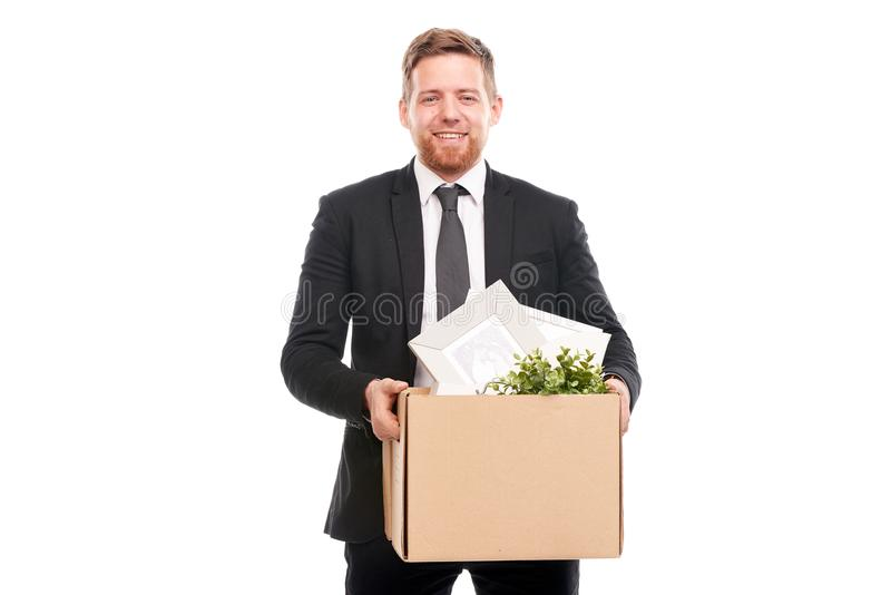 Office worker with personal belongings. Office worker in suit holding box with personal belongings on white background royalty free stock photos